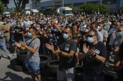 Nissan workers gather during a protest in Barcelona, Spain, Thursday, May 28, 2020. Japanese carmaker Nissan Motor Co. has decided to close its manufacturing plans in the northeastern Catalonia region, resulting in the loss of some 3,000 direct jobs