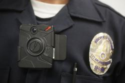 This Jan. 15, 2014 file photo shows a Los Angeles Police officer wearing an on-body cameras during a demonstration for media in Los Angeles