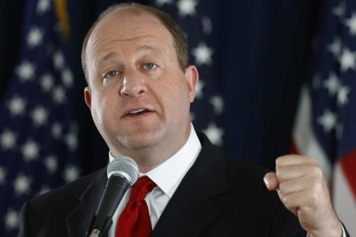 In this Thursday, May 28, 2020, file photograph, Colorado Governor Jared Polis makes a point during a news conference about the state's efforts against the new coronavirus in Denver