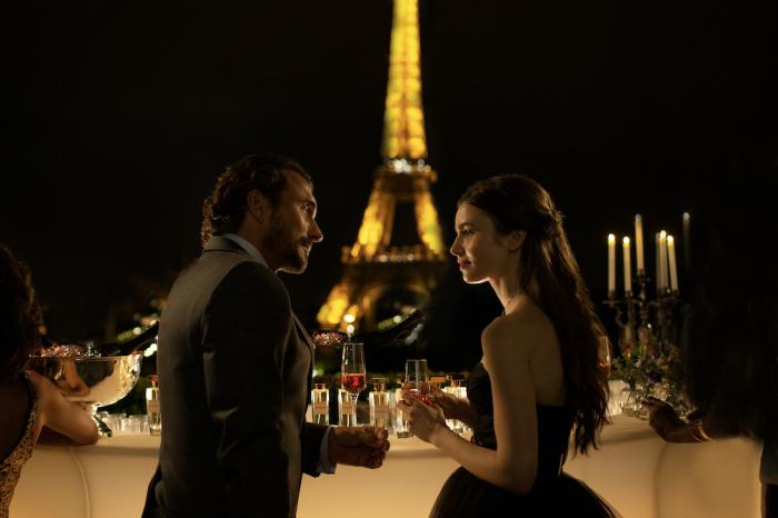 """William Abadie, left, and Lily Collins in a scene from """"Emily in Paris."""""""