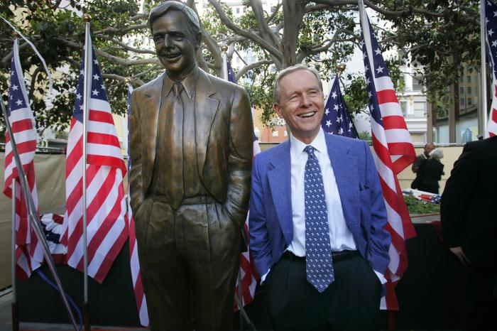 In this Aug. 25, 2007, file photo, former California Gov. Pete Wilson imitates the pose of a statue dedicated in his honor at Horton Plaza in San Diego.