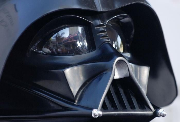 """The premiere of the movie """"Star Wars: Revenge of the Sith"""", is reflected in the mask eyeglasses of iconic baddie character Darth Vader."""