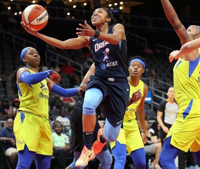 Renee Montgomery (center) played for, and now co-owns the Atlanta Dream.