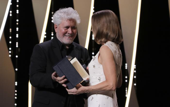 Pedro Almodovar, left, presents Jodi Foster with an honorary Palme d'Or at the opening ceremony of the 74th international film festival, Cannes.