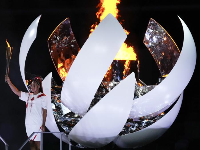 Japan's Naomi Osaka reacts after lighting the cauldron during the opening ceremony in the Olympic Stadium at the 2020 Summer Olympics, Friday, July 23, 2021, in Tokyo, Japan