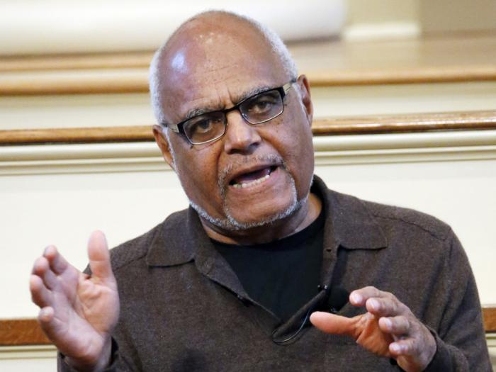 """In this Feb. 5, 2014 file photo shows Robert """"Bob"""" Moses, a director of the Mississippi Summer Project and organizer for the Student Non-Violent Coordinating Committee (SNCC) answers questions about Freedom Summer in 1964 during a national youth summit hosted by the Smithsonian's National Museum of American History, at the Old Capitol Museum in Jackson, Miss."""