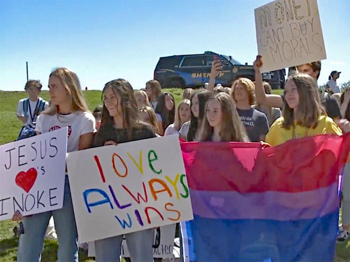Students and alumni protest outside Valor Christian High School in Highland Ranch, Colorado