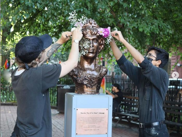 Organizers install a bust of Marsha P. Johnson at the Stonewall National Monument.