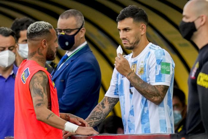 Argentina's Leandro Paredes, right, talks to Brazil's Neymar after the qualifying soccer match for the FIFA World Cup Qatar 2022 between Argentina and Brazil was suspended in Sao Paulo, Brazil, Sunday, Sept. 5, 2021. (AP Photo/Andre Penner)